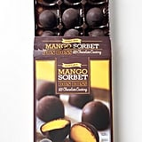 Pick Up: Mango Sorbet Bon Bons With Dark Chocolate Coating ($4)