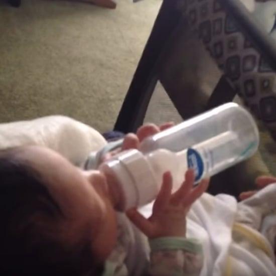 Video of Newborn Holding a Bottle