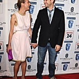 Diane Kruger and Joshua Jackson laughed and held hands as they walked the carpet at LA's BAFTA Tea Party in January 2010.