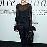 "Olivia Palermo in a peplum-trimmed sheer blouse and trousers at the ""The Ever Changing Face Of Beauty"" W Magazine opening."