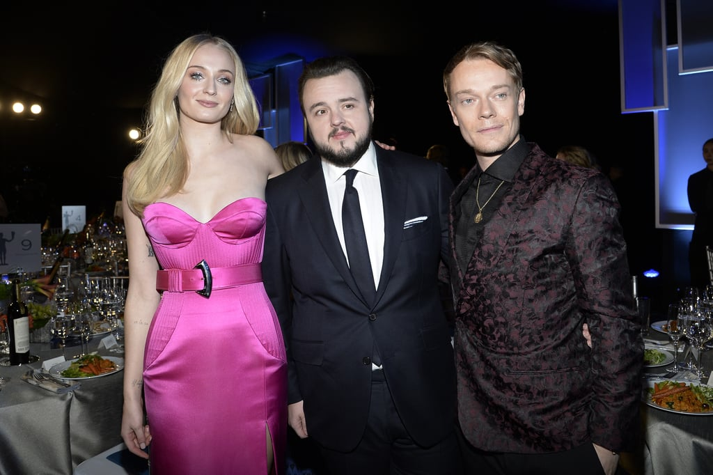 The SAG Awards red carpet is a long way from Westeros, but that didn't stop one of our favourite TV casts from showing out! On Sunday night, the stars of Game of Thrones appeared at the annual event for their last award show together following the show's eighth and final season in April 2019. Sophie Turner and John Bradley both took a walk down the red carpet with their significant others, while Alfie Allen and Gwendoline Christie both took a solo strut that would make the entire Greyjoy line and Ser Brianne of Tarth proud.  The cast already has some celebrating to do as the evening started with the HBO series nabbing the award for outstanding stunt ensemble in a drama series. Their watch might have ended (though ours hasn't thanks to an upcoming GoT prequel series), but we'll definitely never get enough of seeing this cast. Read ahead to see more pictures of the cast at the SAG Awards!      Related:                                                                                                           You'll Want to Press Pause on the SAG Awards Red Carpet, So We Have All the Looks Right Here