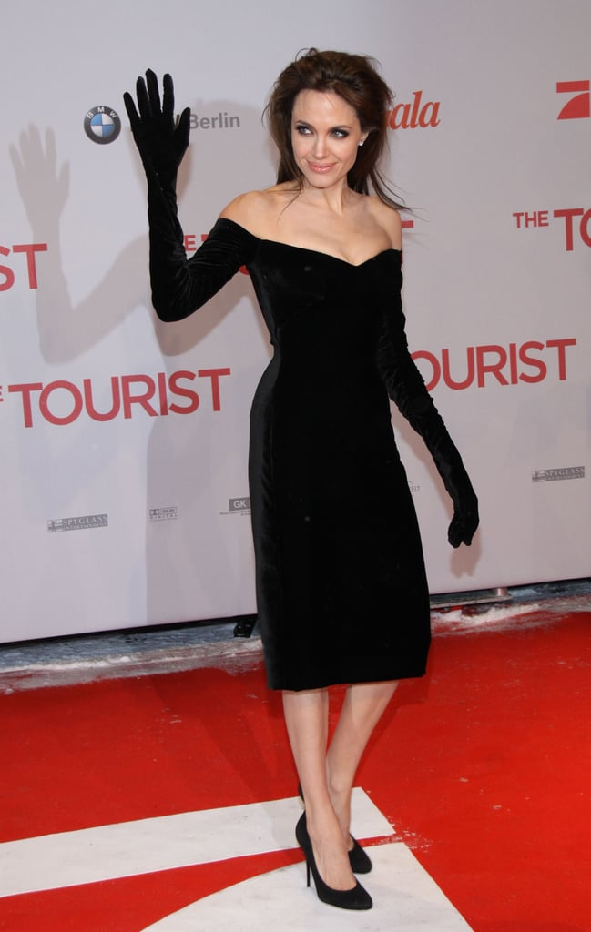 Angelina provided plenty of fashion fodder for critics in 2010 at the Berlin Premiere of The Tourist wearing a black Versace velvet dress with built-in gloves.