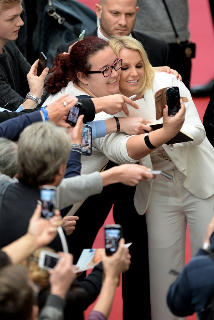 She's taking selfies with fans.