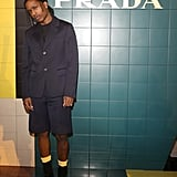 Wearing a Prada Jacket and Bermuda Shorts