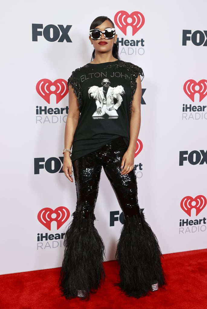 See Photos of H.E.R.'s Glamorous Outfits at the 2021 iHeartRadio Music Awards