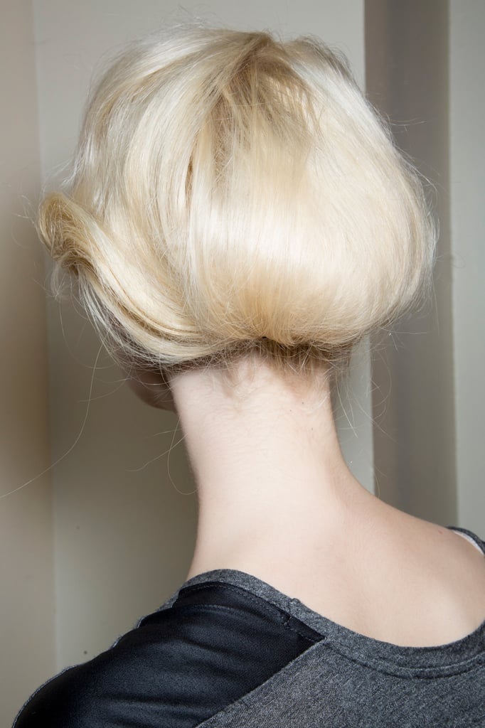 The hair at Giorgio Armani Privé was slightly waved and tucked in at the nape.