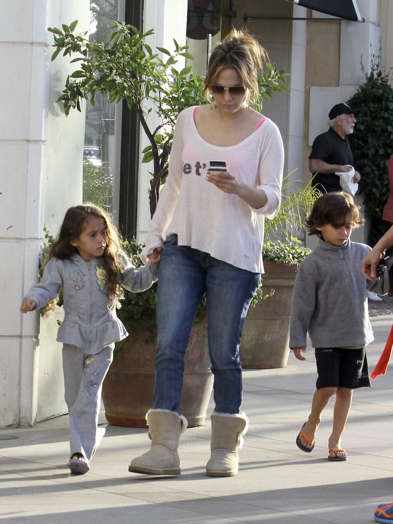 Jennifer Lopez went shopping with her twins, Max and Emme, just outside LA on Friday. The singer and actress went casual in jeans and Uggs as she visited The Commons with the kids and a family friend. Max even helped out his mom by carrying a couple of shopping bags from their stop at Gymboree to their car.  Emme and Max celebrated their fifth birthday just a few weeks ago, and Jennifer shared the exciting milestone on Twitter, along with a picture of the cupcakes she baked for their celebration at school. The busy family are back in LA after traveling the world together last year for J Lo's Love? tour and have taken advantage of their time close to home by marking a new addition to the family. Casper Smart and J Lo adopted a puppy named Roxy this month! Roxy is the second dog the couple have brought home since the beginning of the year — they also welcomed a boxer named Bear back in January.