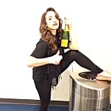 Kat Dennings popped some champagne after the show. Source: Instagram user katdenningss