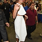 The star also showed some skin at the convention, wearing a cropped white top and skirt set.