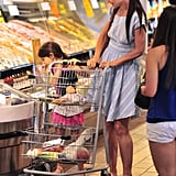 Katie Holmes pushed the cart while Suri Cruise checked out some items at Whole Foods in NYC.