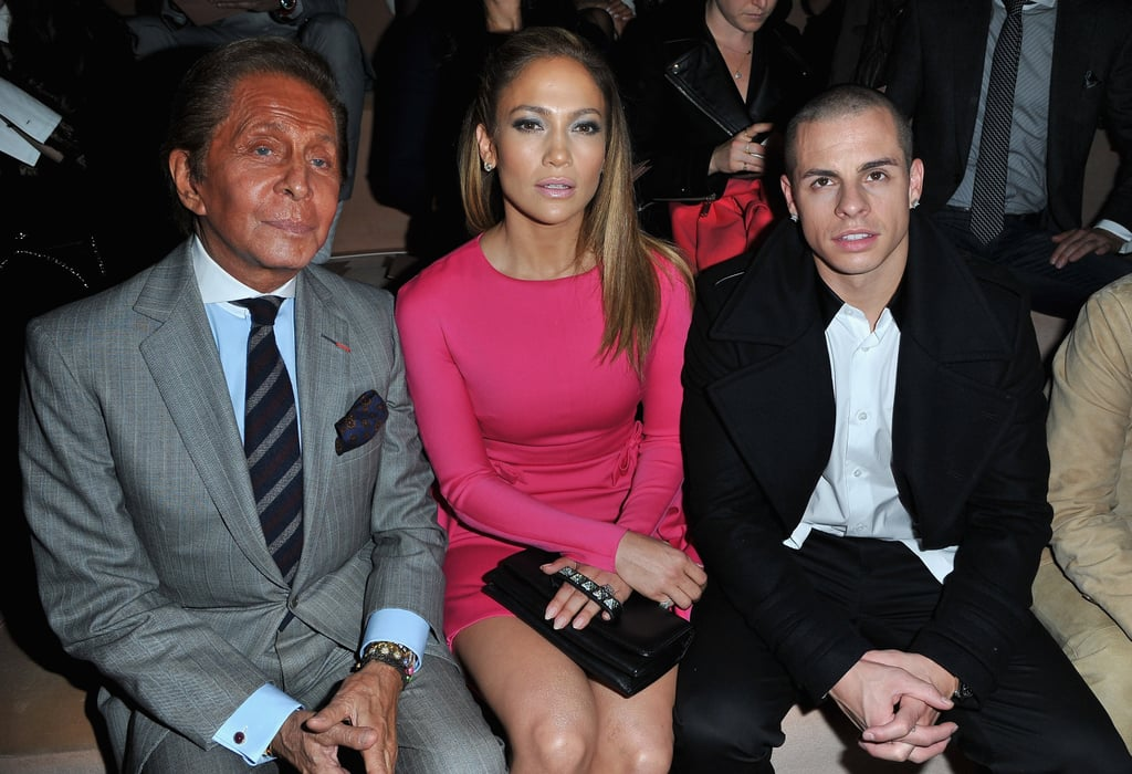 Jennifer Lopez switched into a hot pink minidress, complete with studded black clutch, for the Valentino show.