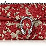 Gucci Dionysus Leather-Appliquéd Coated Canvas Shoulder Bag ($2,990)