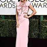 Carrie Underwood in an avant-garde pink dress with Yoko London pearl diamond earrings and a ring and Giuseppe Zanotti shoes in 2017.