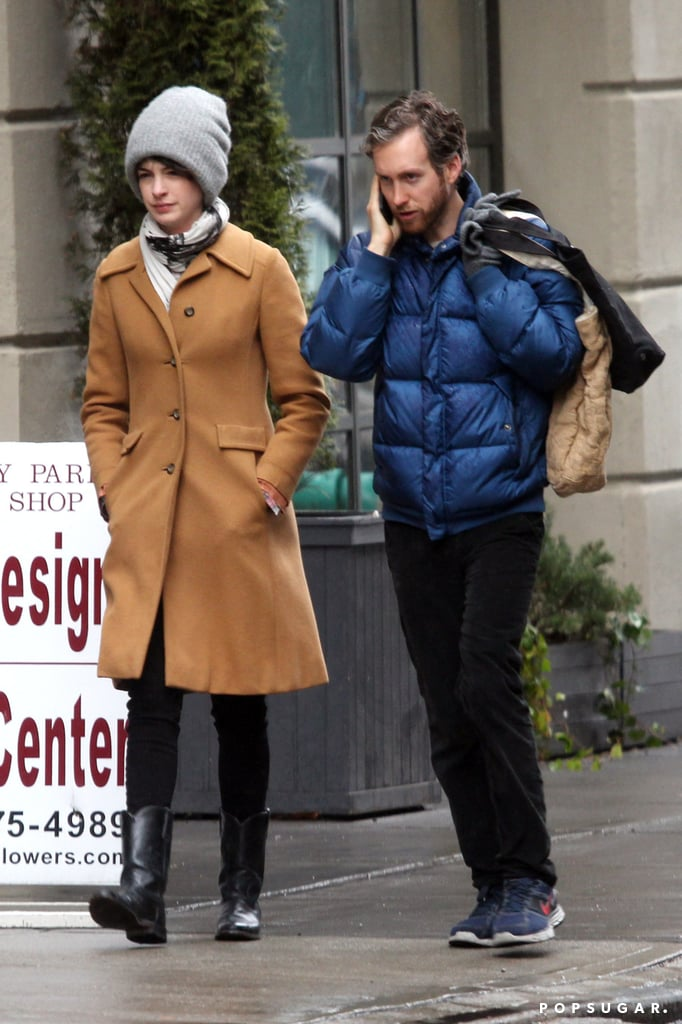 Anne Hathaway walked next to Adam Shulman while he took a call.