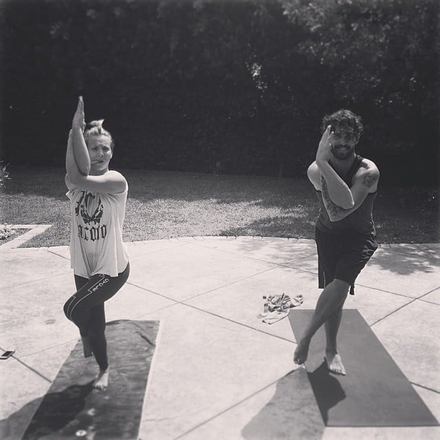 Kaley Cuoco and her husband, Ryan Sweeting, did yoga together. Source: Instagram user normancook