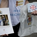 A person sold Diamond Jubilee memorabilia during Ladies Day at the Epsom Derby.