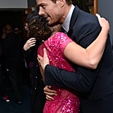 Lea Michele was the lucky recipient of a hug from the handsome Josh Duhamel at the PCAs in January 2013.