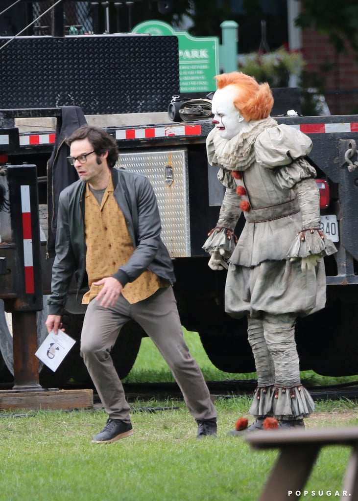Looks like production on It: Chapter Two is in full force, and these new (and hilarious) set pictures prove it. On Sept. 19, Bill Skarsgard was spotted all suited up as Pennywise in Port Hope, Canada. Meanwhile, Skarsgard's scene partner Bill Hader — he's playing the adult version of Richie Tozier —  ran away with a look of sheer terror on his face. Don't worry, though — it was all giggles between takes; Hader and Skarsgard shared a laugh when the cameras weren't rolling. The intriguing set marks the first real look we've gotten at Pennywise in quite a long time. Rest assured that Skarsgard is hard at work terrorizing his costars behind closed doors. Behold the full set in all its glory.      Related:                                                                                                           It: Yes, the Most Bizarre — and Terrifying — Scene From the Book Will Be in the Sequel