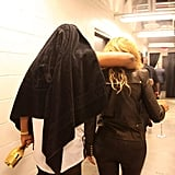 Jay Z slung his arm over Beyoncé's shoulder after a performance at the Barclays Center in October 2012.