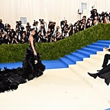 The Adorable Moment When Diddy Laid Down on the Met Gala Red Carpet to Get a Better Look at Cassie's Amazing Dress