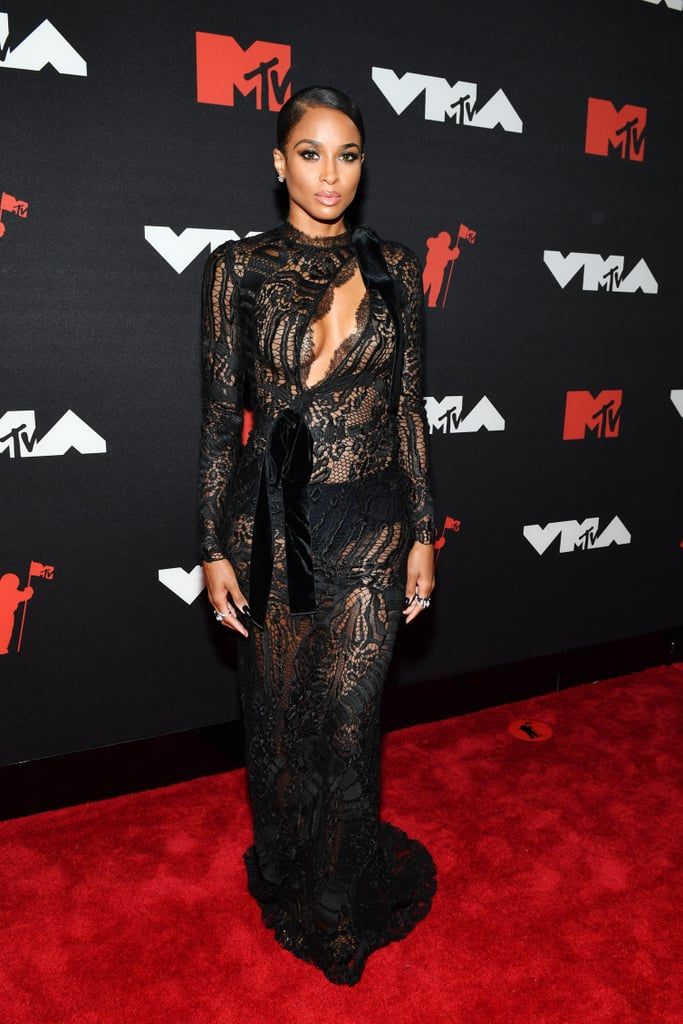 """While Ciara might have had a busy week sitting front row at New York Fashion Week, she certainly didn't forget about the VMAs. The artist was there to introduce Normani ahead of her epic performance of """"Wild Side."""" She chose a long-sleeved black dress for the show, but make no mistake, it wasn't an ordinary LBD — the lace inserts and cutout across the chest made it a classically sexy Ciara look. Styled by Rob Zangardi and Mariel Haenn, the singer's sleek Tom Ford dress was layered over Commando briefs and complete with Yeprem jewels and Femme LA shoes. And in case you were wondering, the exact dress is available to purchase . . . for a cool $28,900, if you're interested. See Ciara's gown from all angles ahead.      Related:                                                                                                           The MTV VMAs Red Carpet Was So Upbeat, the Fashion Alone Made Us Dance"""