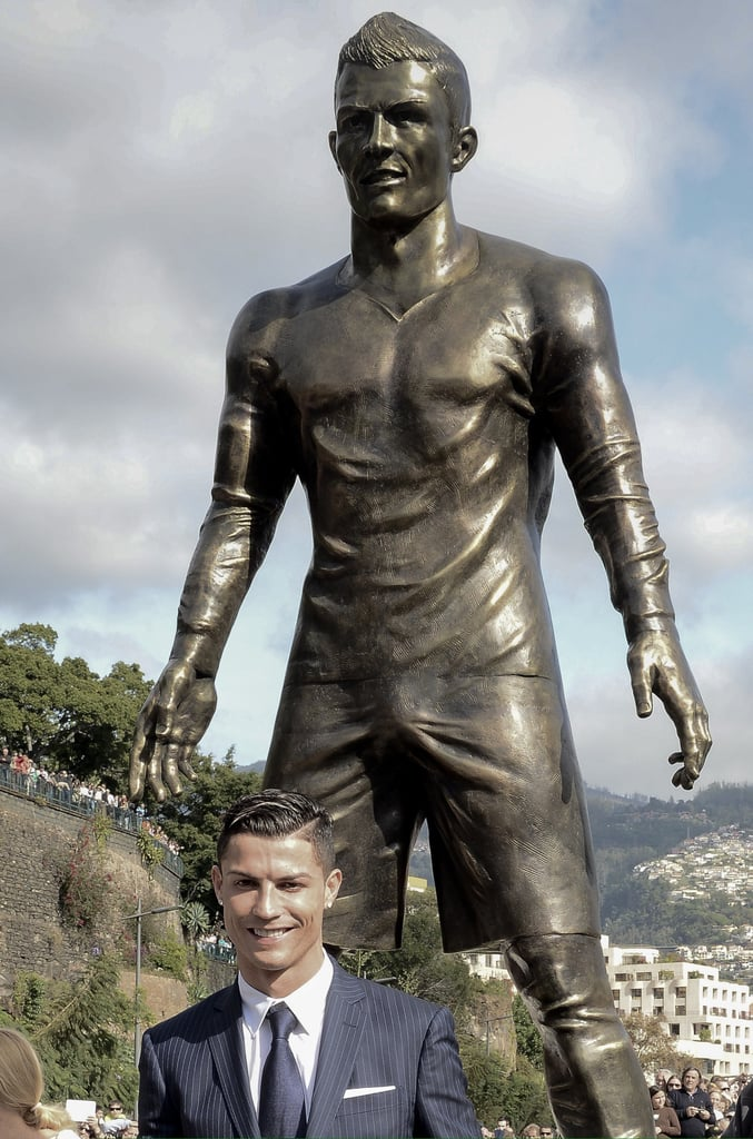 Portuguese soccer player Cristiano Ronaldo was honored by his hometown with a statue of himself — which has, well, a noticeably large bulge. The soccer star stepped out in Funchal, Portugal, on Sunday for the unveiling of the statue, posing for pictures beside the bronze version of himself. And although his handsome smile definitely grabbed some attention, what's truly impossible to ignore is the statue's midsection. The thing is, this isn't even the first time Cristiano has posed beside a version of his bulge, as he stood proudly beneath his crotch when his CR7 by Cristiano Ronaldo underwear line was launched in Spain last year. See all the pictures from the unveiling of the statue, then check out more celebrity bulge moments.