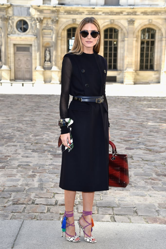 At the Dior show, Olivia chose unexpected accessories like a scarf bracelet, a subtly striped oxblood bag, and tassel-embellished shoes.