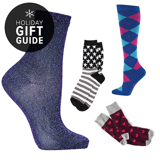 Believe it or not, it's perfectly acceptable to give someone a pair of socks for Christmas. All you have to do is make sure that the pair is perfectly suited to the personality of the recipient, and the rest is as easy as finding the wrapping paper. From the seriously luxurious, hand-knitted options to ones that look like your toes are having a party, these sock options should have you feeling great about investing in them for the holidays.