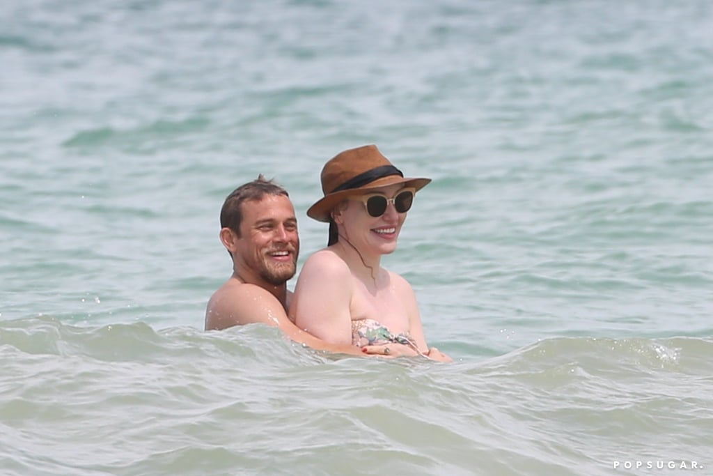 "Charlie Hunnam had a huge smile on his face while spending time on the beach in Hawaii with his girlfriend, Morgana McNelis, this week. The shirtless star was spotted with his arms around Morgana during their PDA-filled day, and the couple cuddled up while hanging out in the water. Charlie's been in Hawaii for several weeks filming Triple Frontier alongside costars Ben Affleck, Oscar Isaac, and Garrett Hedlund, and he's been seen hanging out with the cast and preparing for the film during a few shirtless days on the beach. Charlie and Morgana have been dating for several years, and they've shared more than a few sweet moments together in the spotlight. He's made several thoughtful comments about their relationship over the years, too, at one point saying, ""This is a girl I love very much and have spent the last 11 years of my life with and hope to spend the next 60 years."" Yet another reason to love Charlie, right? Check out all the best pictures from the couple's beach day, then look back at Charlie's Hollywood evolution.      Related:                                                                                                           17 Sexy Charlie Hunnam Smirks That Might Seriously Make You Fall in Love"