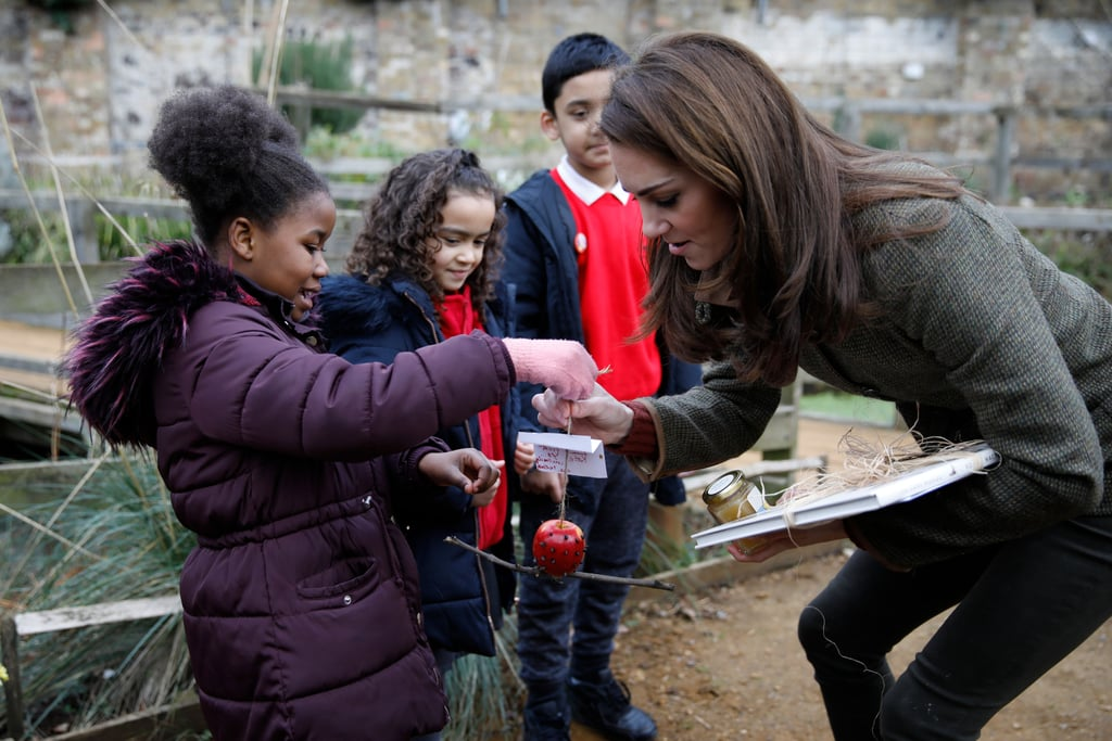 Kate accepted homemade gifts from a little girl at the Islington community garden in January 2019.