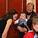 When This Bold Baby Stuck His Tongue Out at Kate at a Fancy Gala
