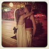 Poppy Delevingne planted a smooch on her younger sister, Cara. Source: Instagram user poppydelevingne