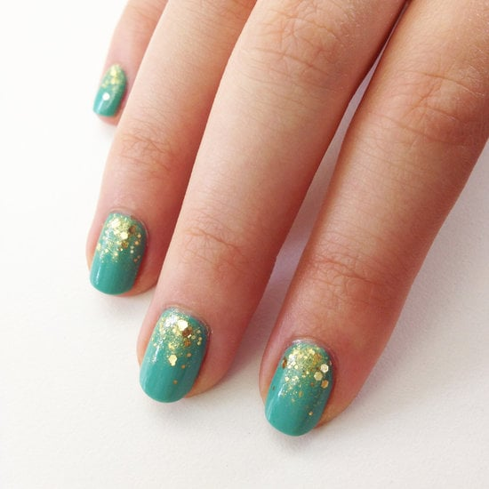 A gold glitter gradient is the perfect accent to a teal polish hue.