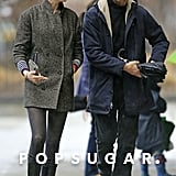 Anne Hathaway braved the NYC rain for a coffee date with husband Adam Shulman.