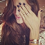 Izabel Goulart showed off a dark manicure and gold rings. Source: Instagram user izabel_goulart