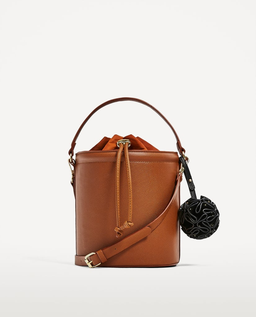 The Zara Crossbody Bag ($50) is supported by extra detail.