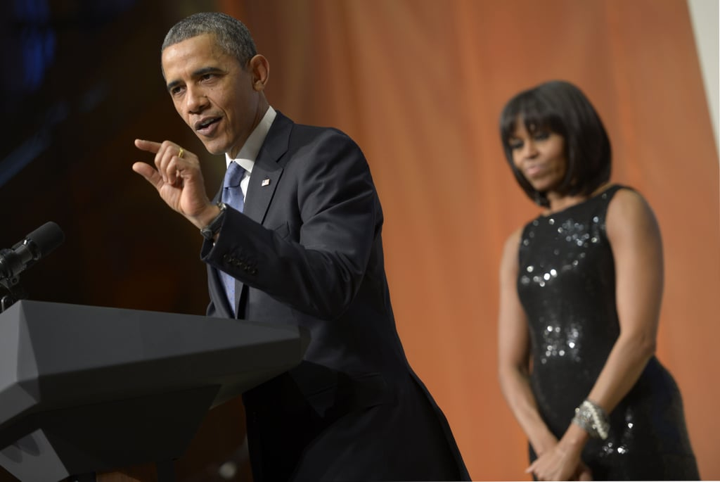 Even in the background of the presidential inaugural reception, Michelle shines, especially with a little help from this black shimmery Michael Kors gown.