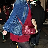 Katie Holmes left her show in NYC wearing a red dress and denim jacket.