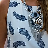 So what if you can't decide between a bold feather-print tank and an attention-grabbing statement necklace — wear them both together for a mix-and-match vibe.