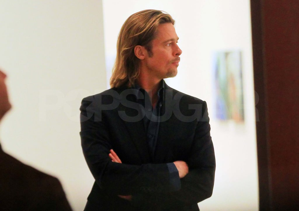 """Brad Pitt stopped by the Lehmann Maupin Gallery to check out their Sandro Kopp exhibit in NYC last night. Sandro is a German artist and the boyfriend of Tilda Swinton, who worked with Brad on The Curious Case of Benjamin Button and Burn After Reading. Brad's been making the rounds chatting up Moneyball in the Big Apple all week including a stop by the Today show and The Daily Show. He also visited Pace University to tape an episode of Inside the Actors Studio, which will air on Feb. 10.  Brad opened up about his family life in the interview by sharing a glimpse into their morning routine with the kids saying, """"Listen, I admit there's times like 'We gotta get up. Get up! Here's your shoes. Here's your shoes. Drink this Coke. Drink this Coca-Cola. Drink it all. Right now! Drink it! Drink it! Drink it!' Just so we could get 'em up and going."""" He'll continue to be in the spotlight since he and Moneyball are up for Oscars, though we'll have to wait until the big show on Feb. 26 to see more of Brad and Angelina Jolie's hot red-carpet moments."""