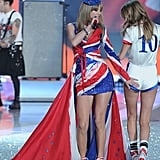10. Cara Delevingne, who once dated Harry Styles, got a playful tap on the butt from Taylor Swift, who famously dated the One Direction star as well.