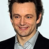 Michael Sheen flashed the press a smile on the red carpet.