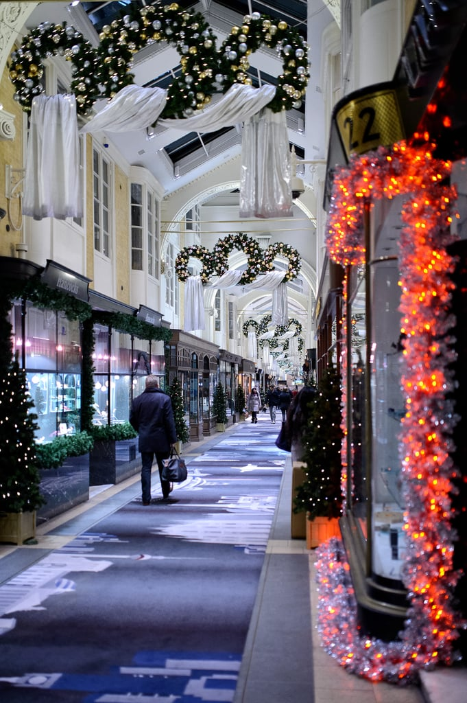 In London, people shopped and checked out window displays at the Burlington Arcade.