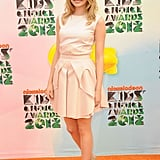 How cute is Emma's Antonio Berardi cream-hued top and skirt combo? To polish her 2012 Kids' Choice Awards outfit off, she wore nude Alejandro Ingelmo sandals and toted a Fendi clutch.