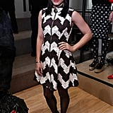 Vanessa Hudgens went mod at the Chloë Sevigny for Opening Ceremony show in a printed black-and-white dress by Opening Ceremony, black patent ankle boots, and dangling cross earrings.