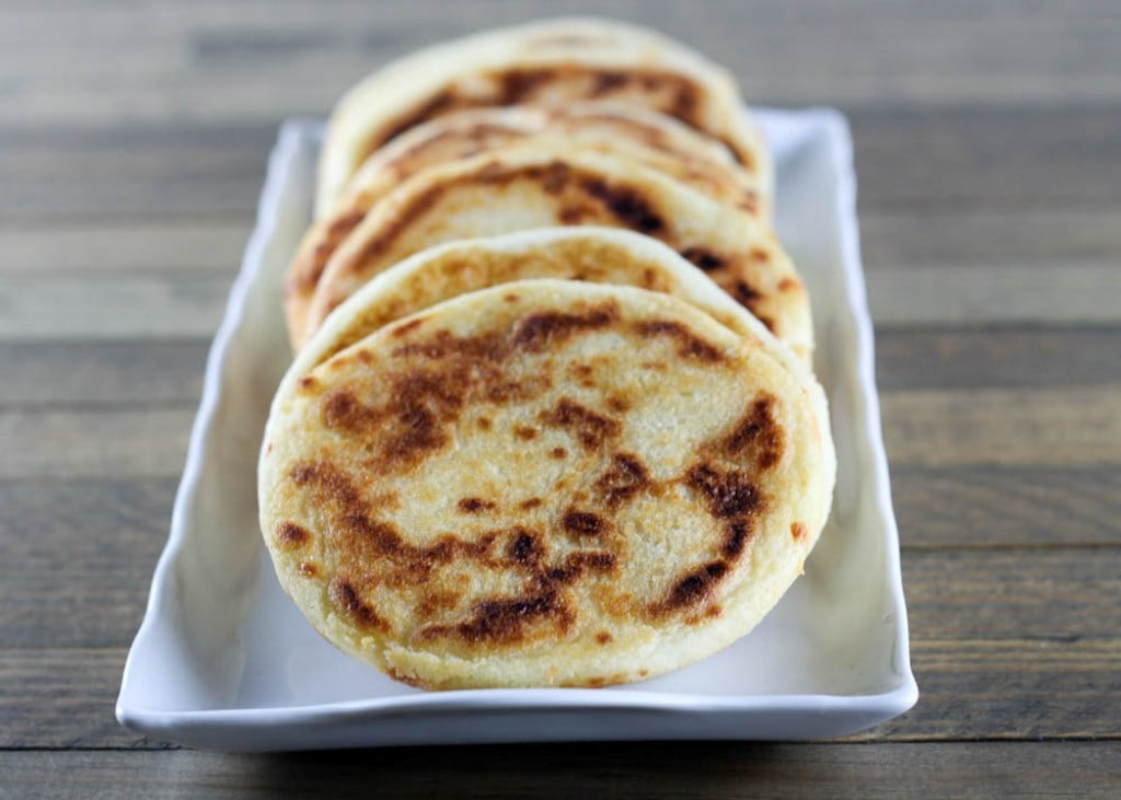 When the idea of a cold sandwich makes you want to jump under the covers and protect yourself from the cold, try arepas, corn pockets stuffed with various savory fillings like shredded beef, black beans, and cheese.