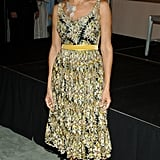 SJP debuted extra flower power in a floral-print tea-length dress, matching necklace, and rosette-adorned slingback pumps for the September 2005 Lovely fragrance launch in New York City.