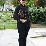 Black suiting got a modern update with a cropped jacket and an armful of bangles.