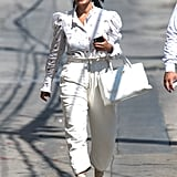 Tracee Wore the Céline Boots While Arriving to Jimmy Kimmel With a Romantic Blouse and Chanel Bag