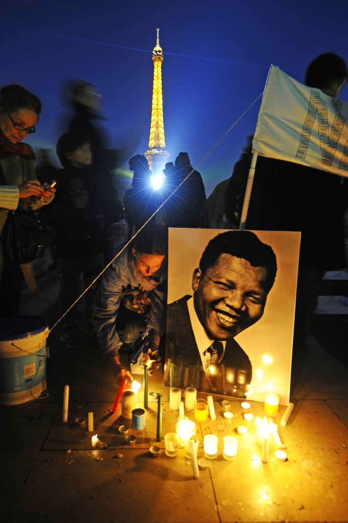 Candles were lit beside pictures of Nelson Mandela for the Parisian tribute on Human Rights Square.